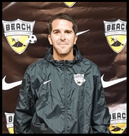headshot of beach fc ussda academy coach anton arrache