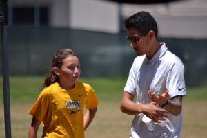 photo of Isaac Ayala Beach FC talking to player