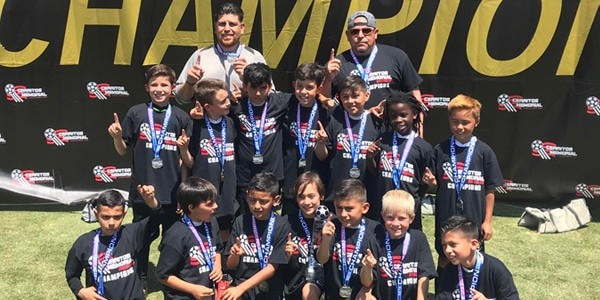 Group photo of Beach FC LB B08 Artiaga winning Cerritos Memorial Challenge Cup 2018