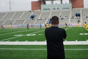 Beach FC coach watches USSDA game