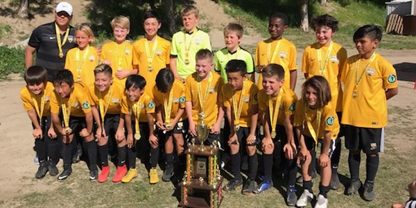 team photo with trophy Beach FC B07 ECNL champions SWSC Spring Madness 2019