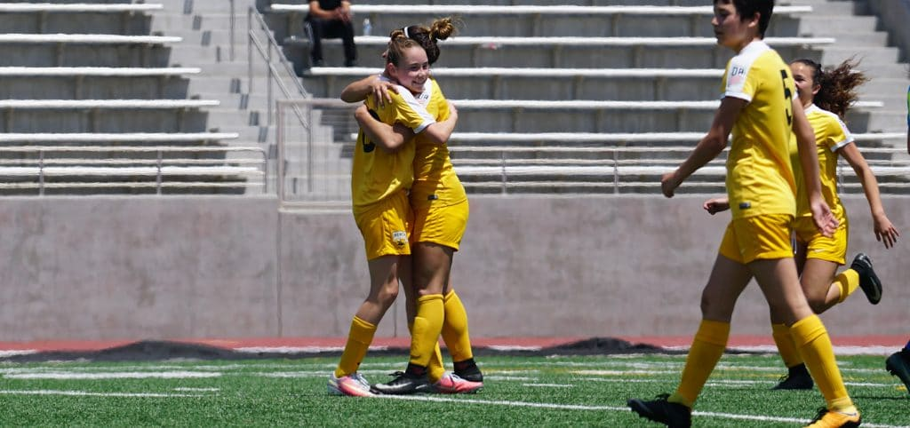 Beach FC player Olivia Moultrie celebrates a goal with Makayla DeMelo